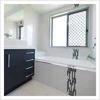 Laminex bathroom with glass tile features